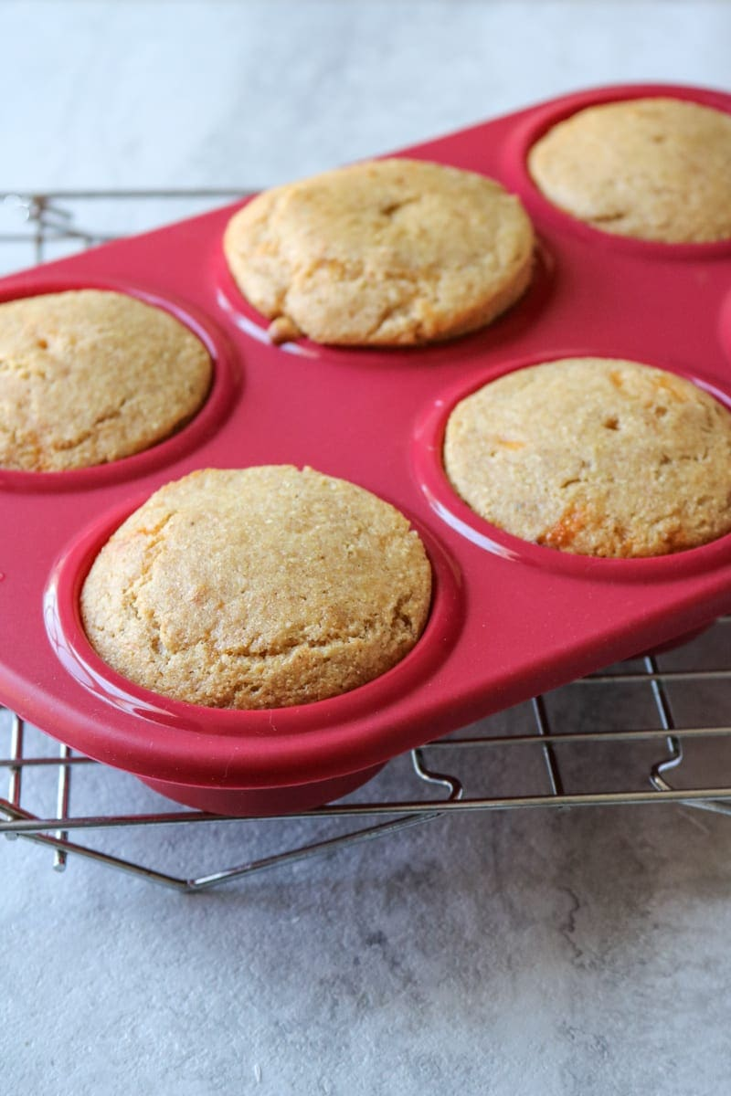 Baked Cornbread muffins in red silicone muffin tin liner