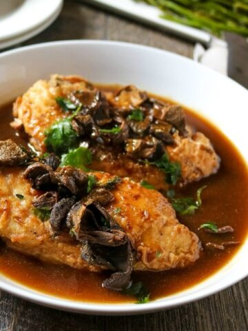 Chicken Marsala on white serving platter