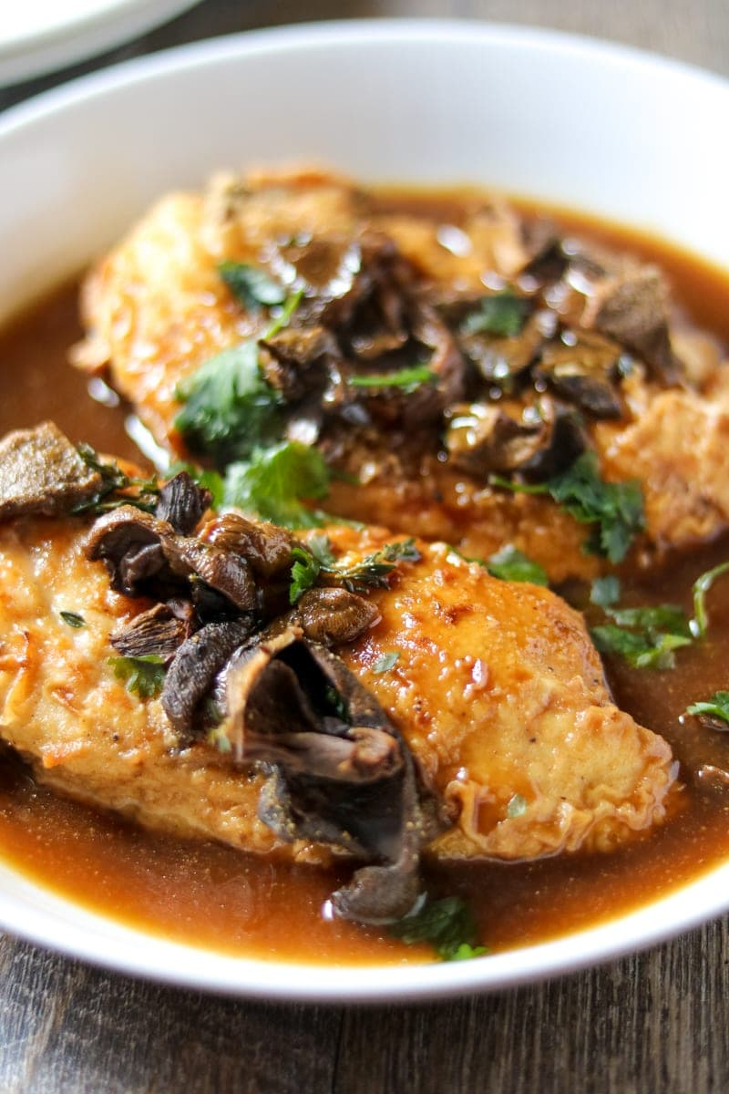 Up close of plated chicken marsala in homemade mushroom broth