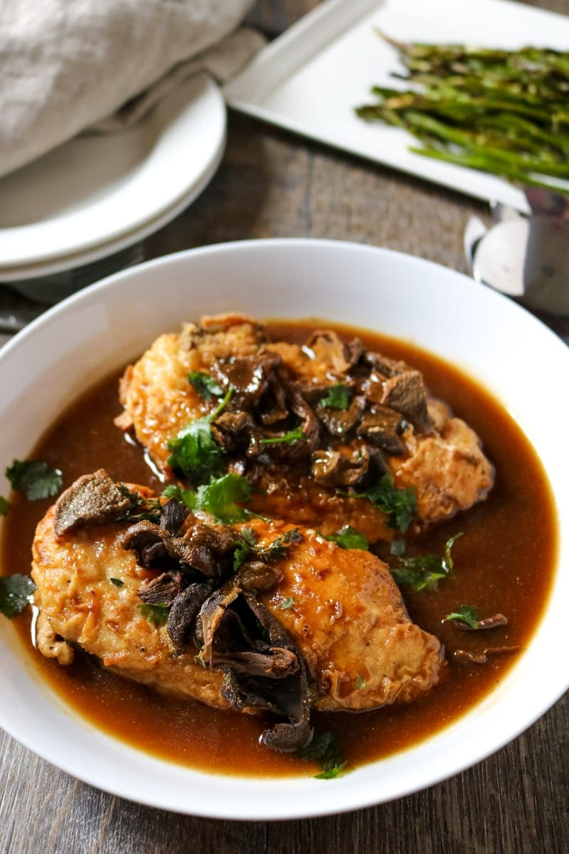 Chicken Marsala served in white bowl.