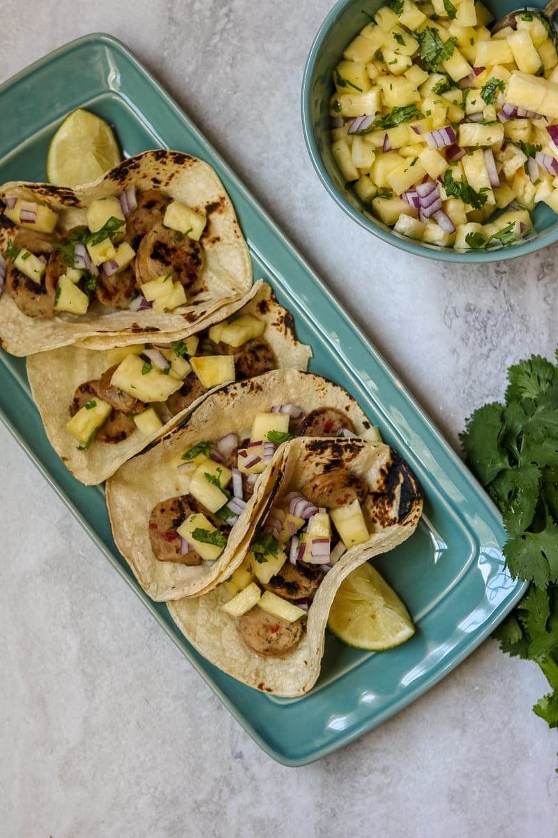 Platter of Chicken Sausage Tacos with Pineapple Salsa