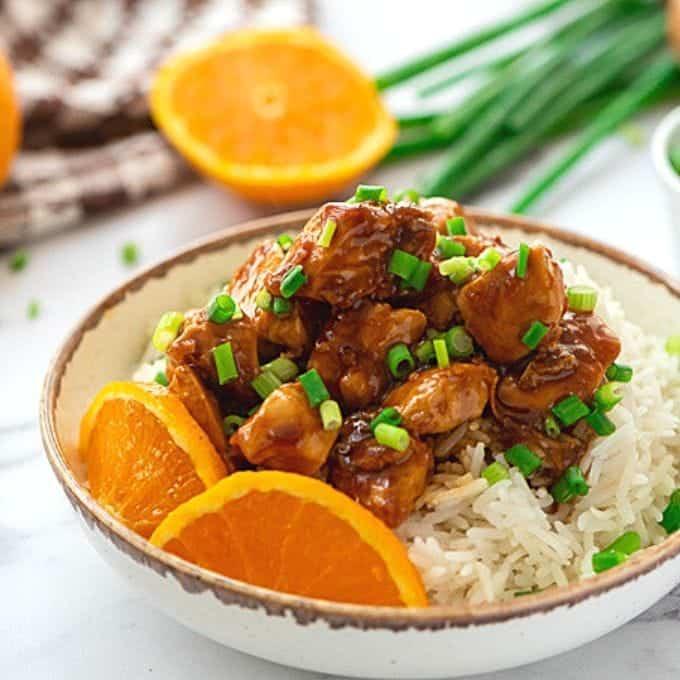 Bowl of orange chicken served over rice