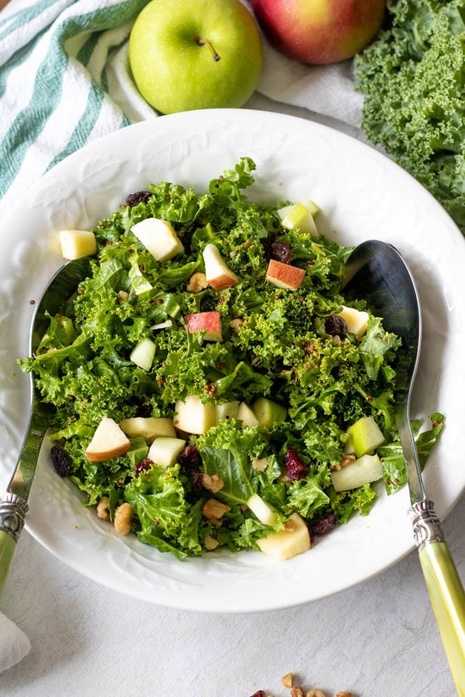 Kale Salad with Apples and Walnuts in serving dish