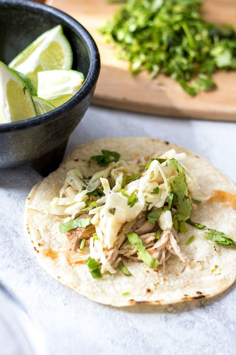 Pork Carnitas with Mexican Slaw: Sweet and spicy shredded pork makes the perfect base for tacos. Finished with a fresh Mexican Slaw.