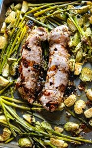 Sheet Pan Fig Glazed Pork Tenderloin with Roasted Vegetables: Simple one pan meal featuring tender pork tenderloin with roasted brussel sprouts and asparagus with a Maple Fig glaze.