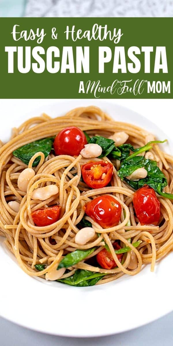 This healthy pasta dinner is easy yet elegant! Tender spaghetti is tossed with perfectly seasoned white beans, blistered tomatoes, fresh spinach, and olive oil, for a simple pasta recipe that comes together in under 30 minutes.