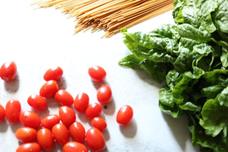 whole wheat pasta, spinach, and tomatoes
