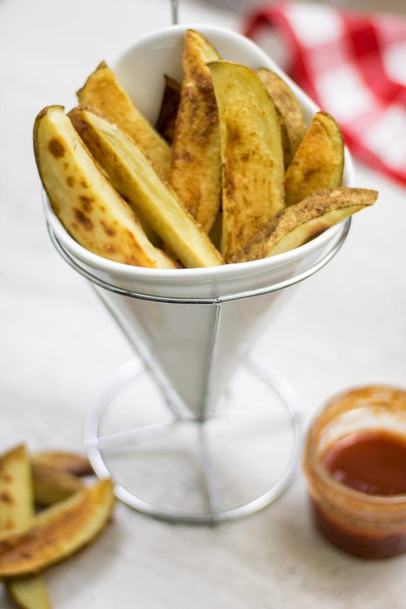Oven Baked fries piled in fries holder