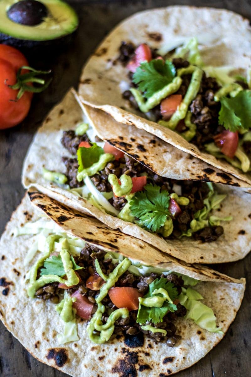 Easy Lentil Tacos with Avocado Cream: Lentils are simmered with taco seasoning for the base of a hearty, meatless taco. Finished with avocado lime cream and crunchy cabbage for a perfect balance in flavors and texture.