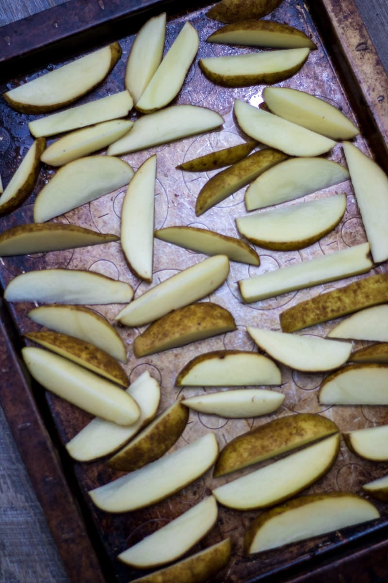 Potato Wedges arranged on baking sheet
