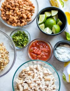 Using Up Leftovers: Making carnita burrito bowls with pantry staples to reinvent leftovers.