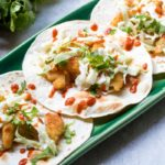 Easy Asian Fish Tacos with Ginger Slaw: Sesame encrusted Cod is wrapped in charred tortillas and topped with a fresh Ginger Slaw for a fresh and easy dinner full of flavor.