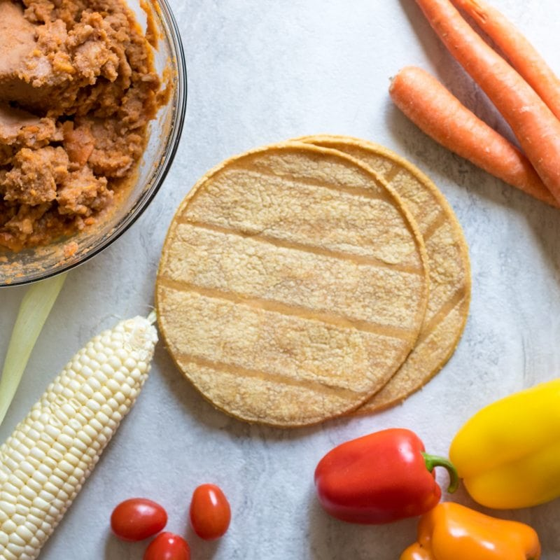 Southwestern Tostada: Gluten-free, veggie rich bean tostada that is the perfect kid-friendly, quick meal. Plus tips on how to raise an adventerous eater.