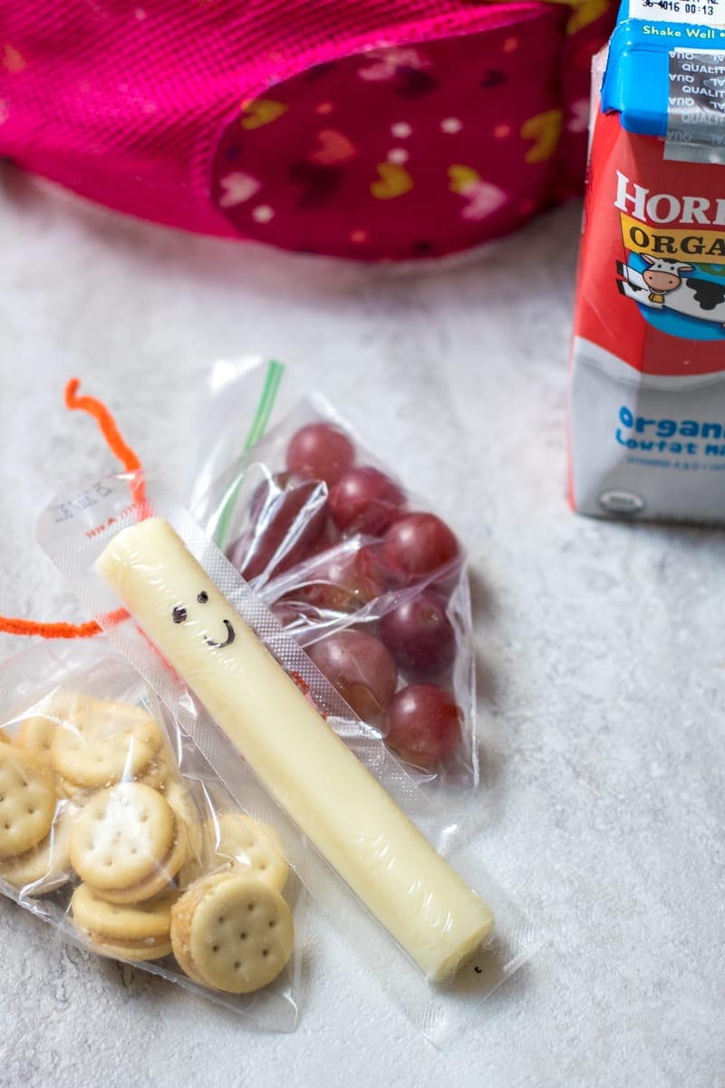 DIY Butterfly Snack Bags: An easy and healthy addition to any lunch, these Butterfly Snack Bags are sure to bring a smile to any child. Step-by-Step Instructions on how to make the bags and fill with organic snacks.