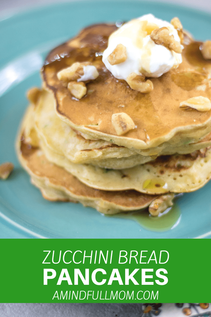 Zucchini and crushed pineapple are folded into tender pancakes and topped with sweet yogurt and crushed nuts--these Zucchini Bread Pancakes are a great way to enjoy your zucchini.