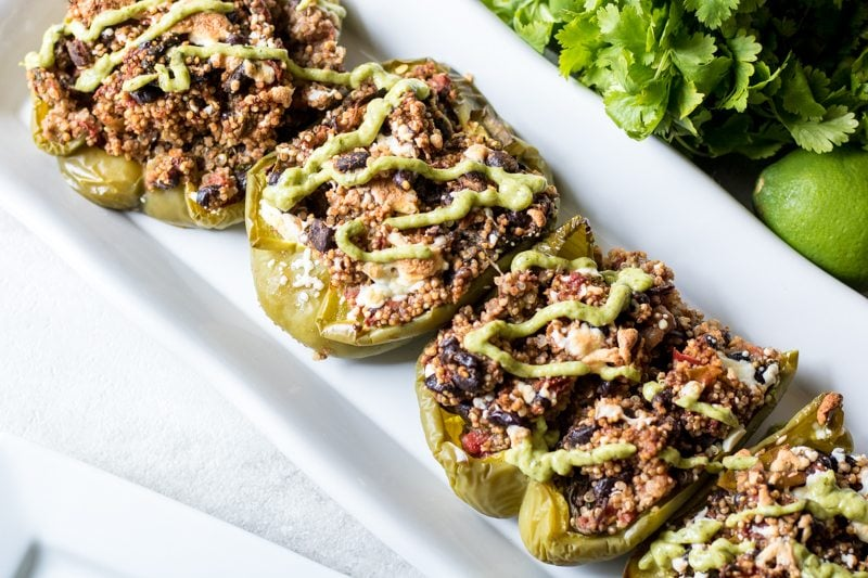 Vegan Tex-Mex Stuffed Pepepers: Traditional stuffed peppers get a Tex-Mex spin complete with black beans, hearty grains, and an avocado cream finish. These vegan stuffed peppers are full of protein and are so tasty they will even win over the meat lovers in your family
