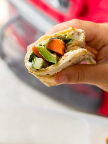 Vegetarian Wrap cut open to reveal fresh vegetables