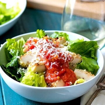 Bowl of Chicken Parmesan Salad with fresh tomato sauce