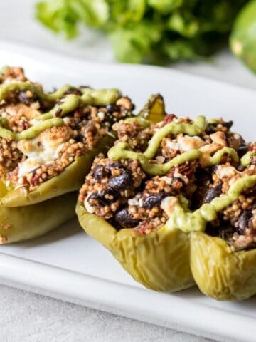Vegan Tex-Mex Stuffed Pepepers: Traditional stuffed peppers get a Tex-Mex spin complete with black beans, hearty grains, and an avocado cream finish. These vegan stuffed peppers are full of protein and are so tasty they will even win over the meat lovers in your family.