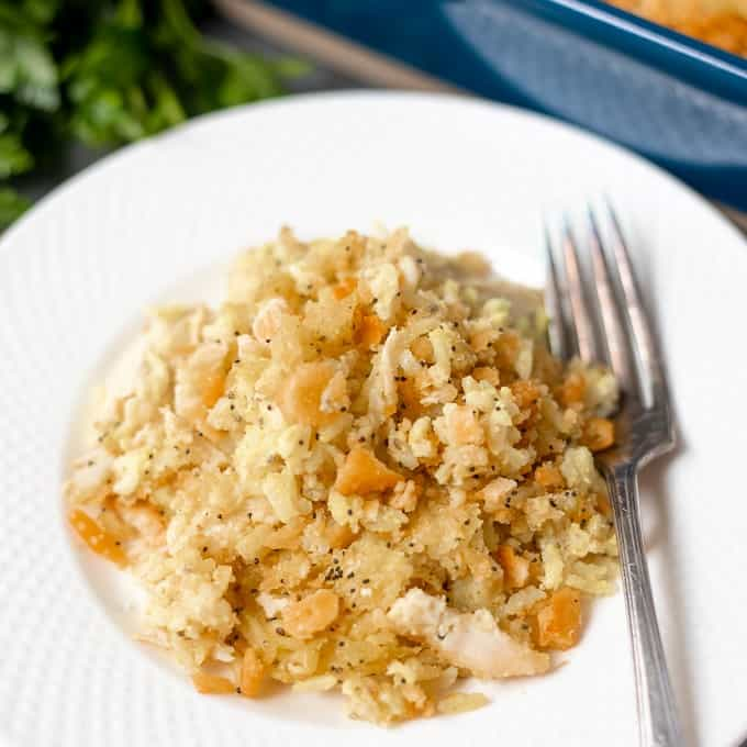 White Plate with chicken poppy seed casserole and fork