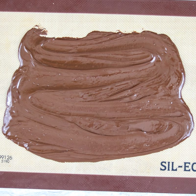 Melted chocolate on sil pat