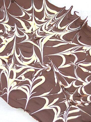 Homemade Marbled Chocolate Bark on white board