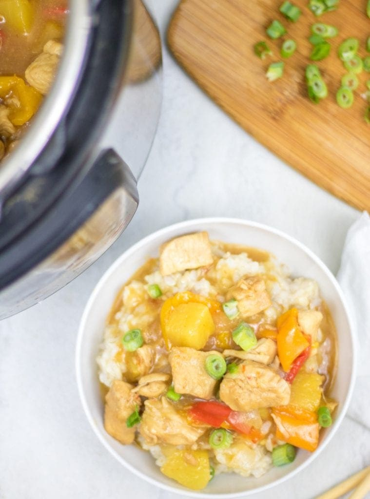 Instant Pot Sweet and Sour Chicken served in white bowl over rice.