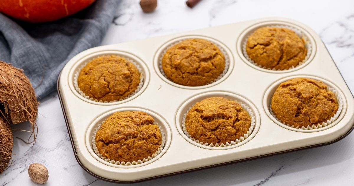 Baked Pumpkin muffins in silver muffin tin on cooling rack