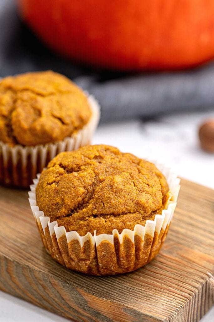 Healthy Pumpkin Muffin on wooden cutting board