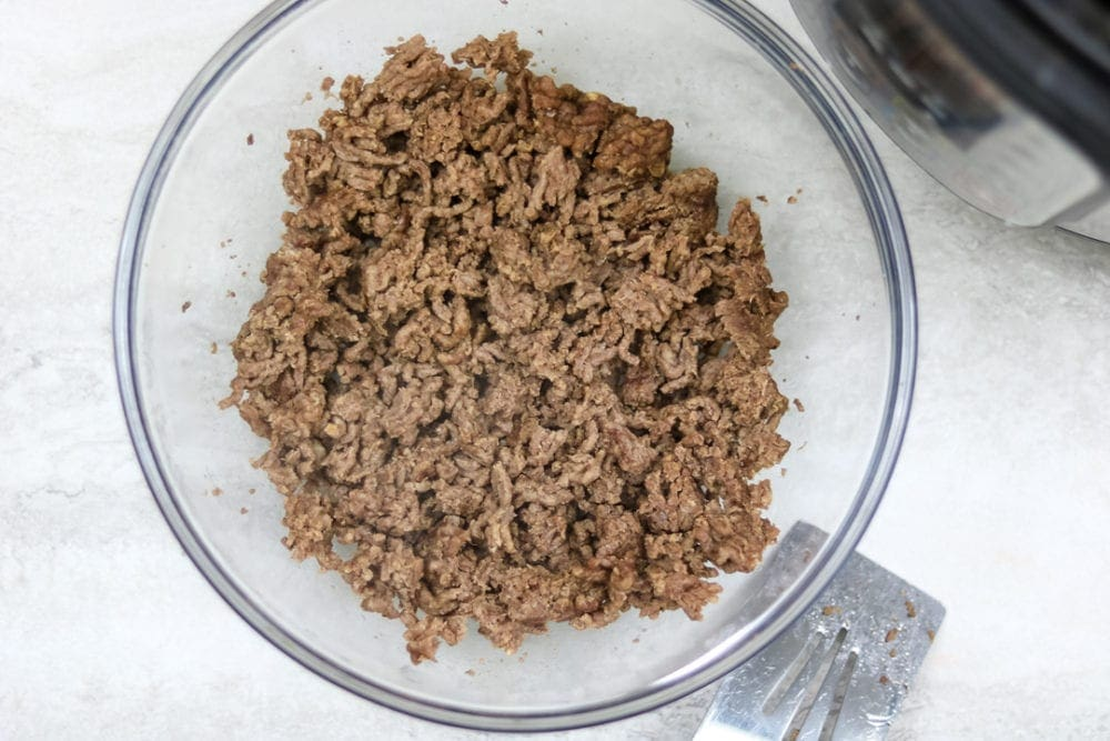 A clear bowl of perfectly tender ground beef cooked from frozen in Instant Pot.