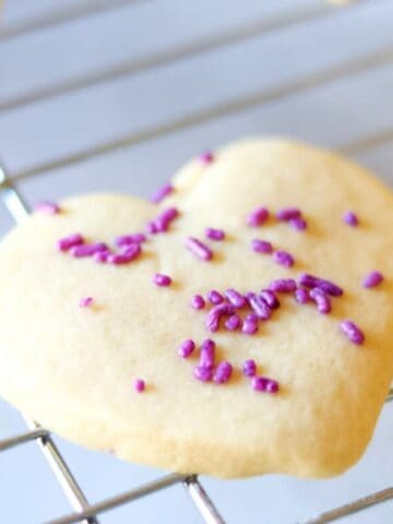 Heart Cut-Out sugar cookie on cooking rack.