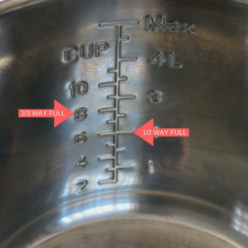 Red arrows showing where to fill the instant pot to for pressure cooking