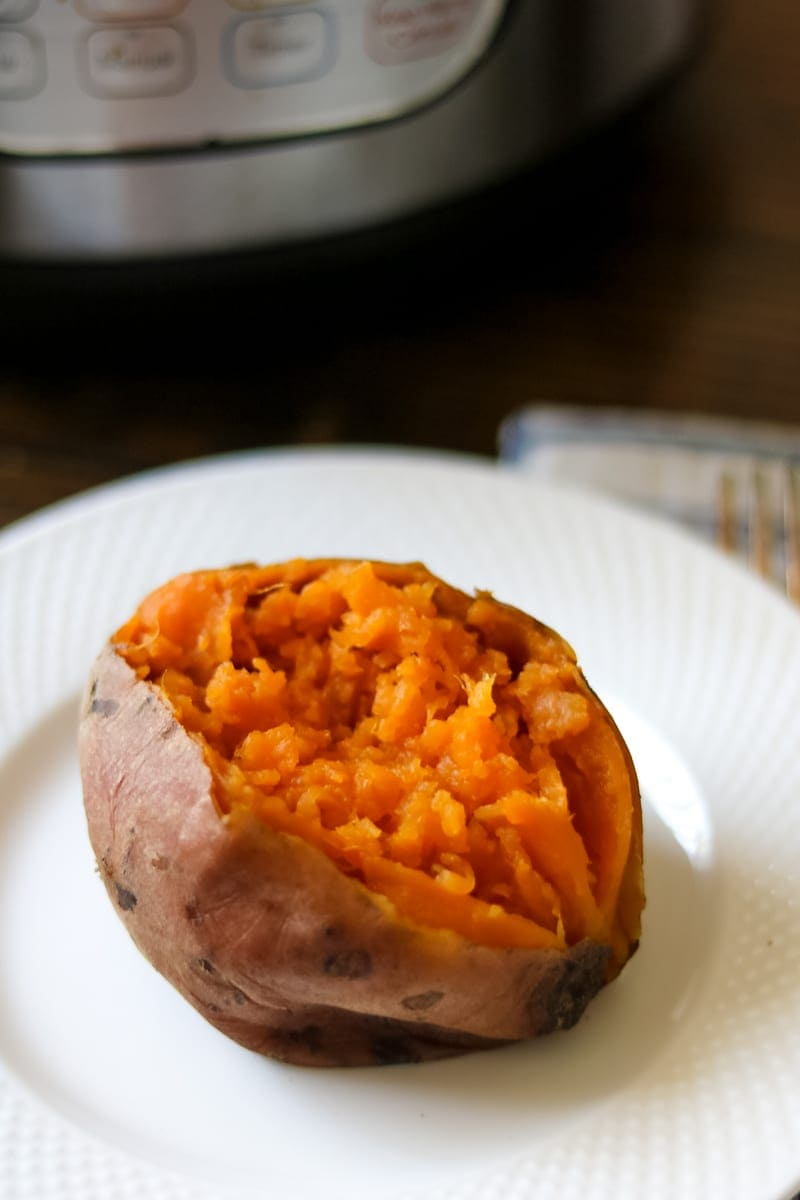 Perfectly soft sweet potato on white plate that was cooked with Instant Pot.