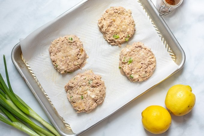 4 tuna cakes on parchment lined sheet pan