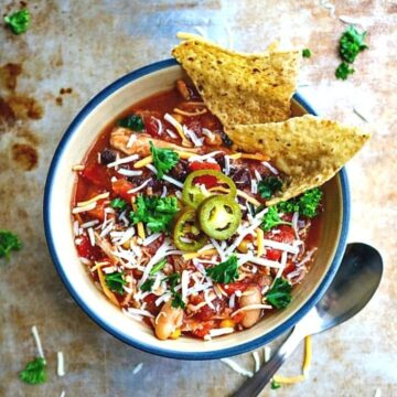 Bowl of Crock Pot Chicken Chili topped with cheese