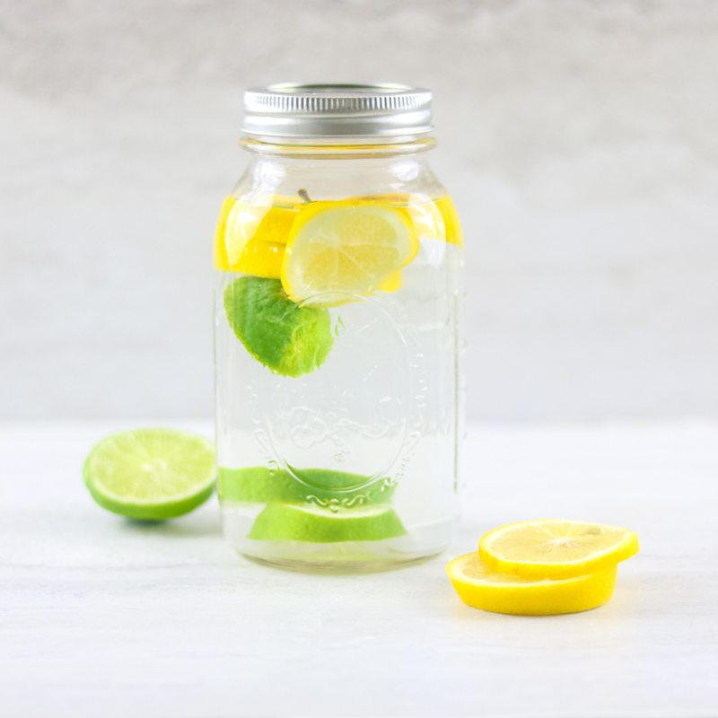 Glass Jar filled with Lemon Lime Infused Water