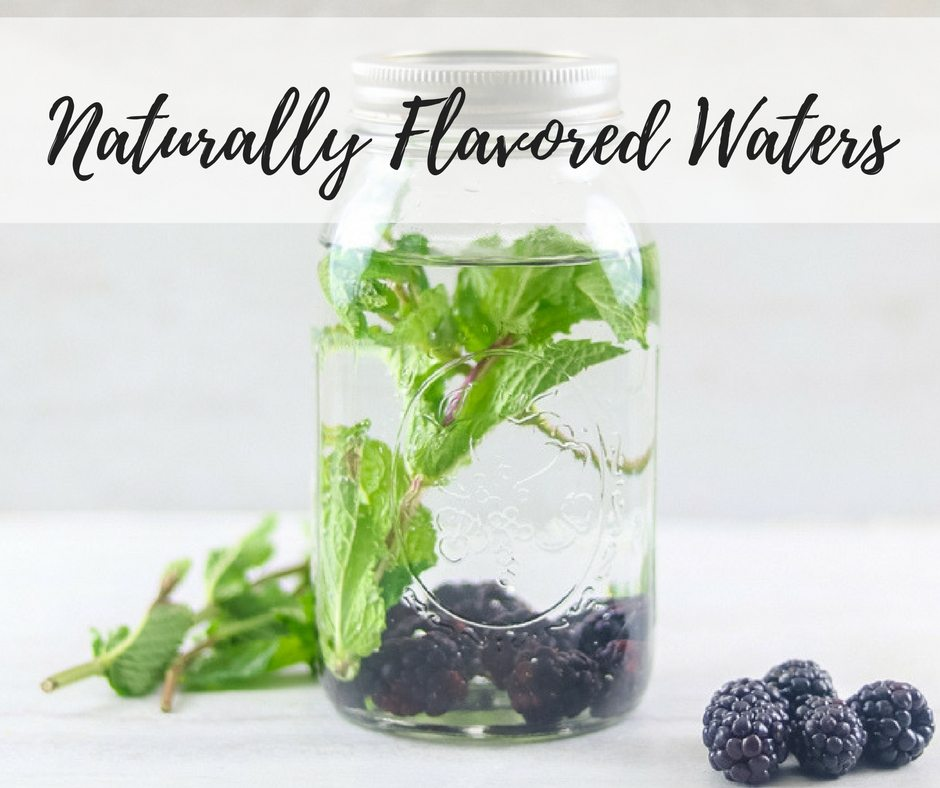 A glass jar filled with Blackberry Mint Infused Water with an overlay of text that reads: Naturally Flavored Waters.