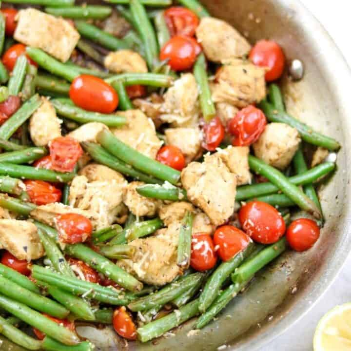 Lemon Chicken with green beans and tomatoes in skillet