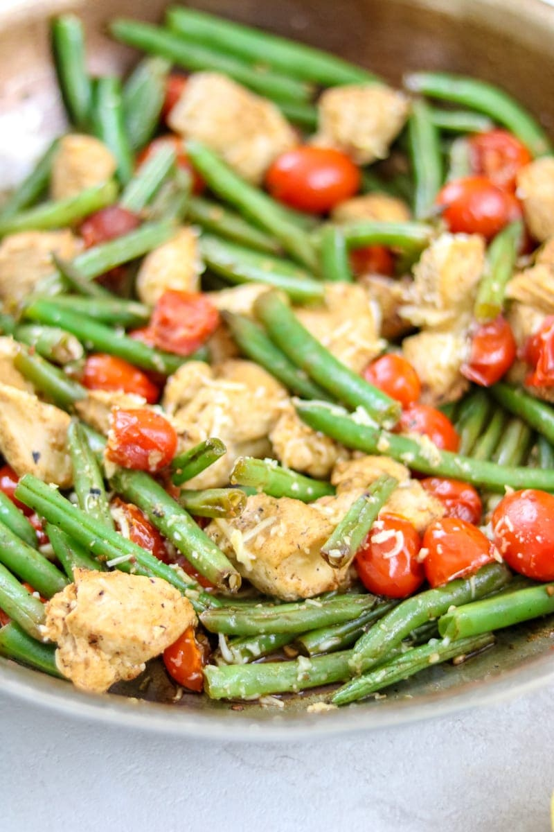 Easy one pan skillet chicken dinner with green beans and tomatoes