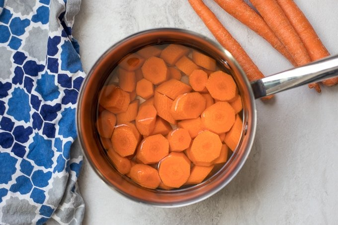 Pan with carrots slices covered with water