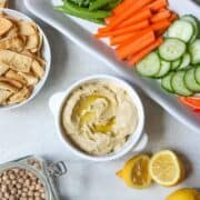 Hummus with fresh lemons and dried chickpeas on the side