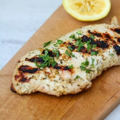 Grilled Lemon Chicken on wooden cutting board