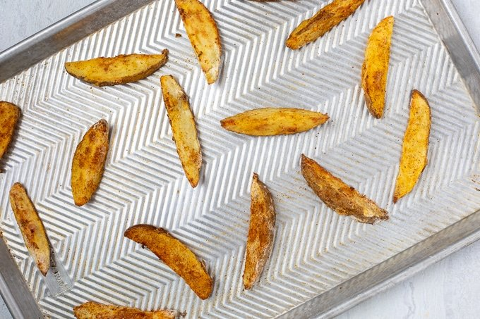 Baked Potato Wedges on cooking sheet