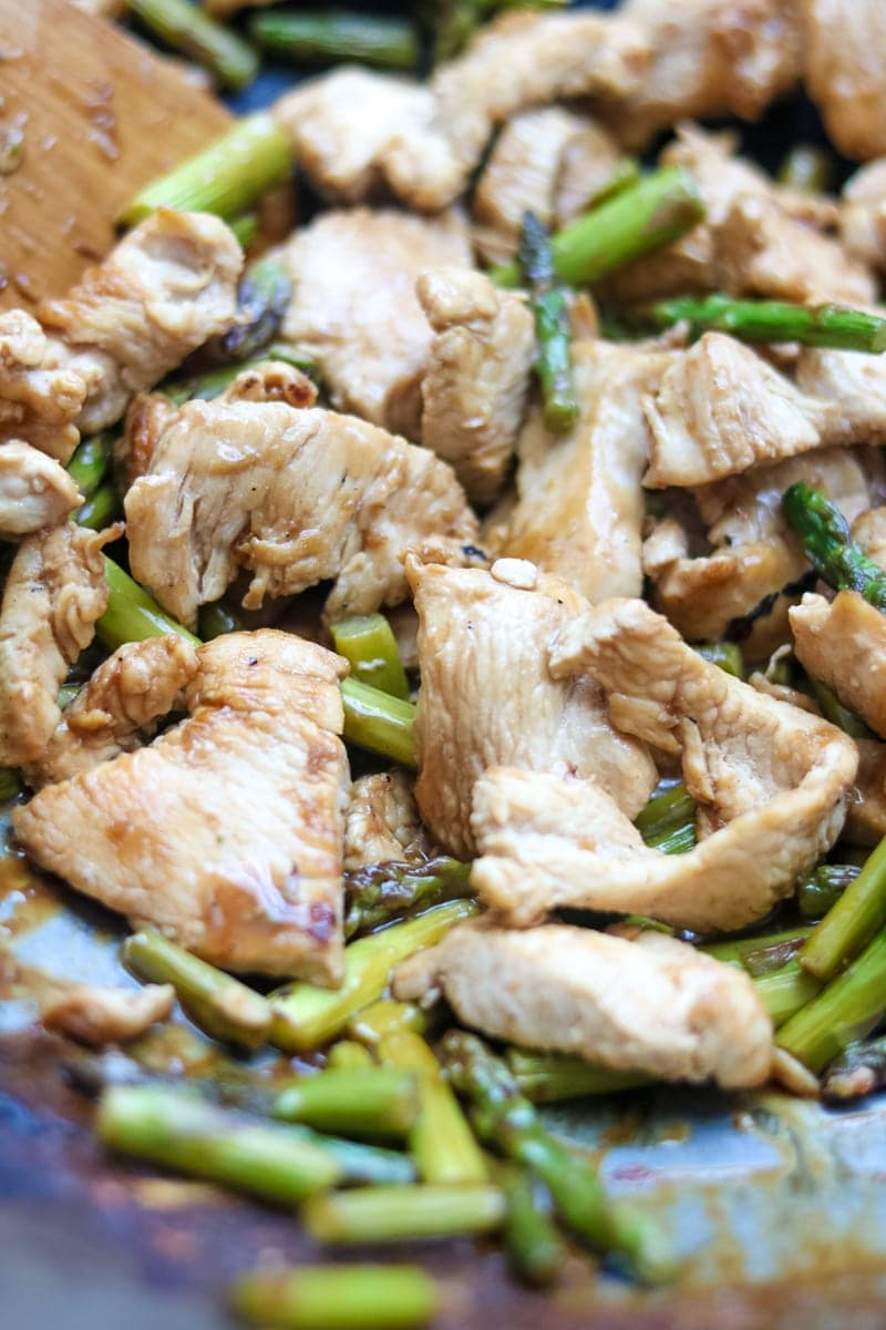 Close up of skillet filled with healthy vegetable chicken stir fry