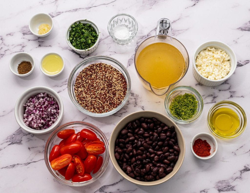 Ingredients for quinoa salad on white counter