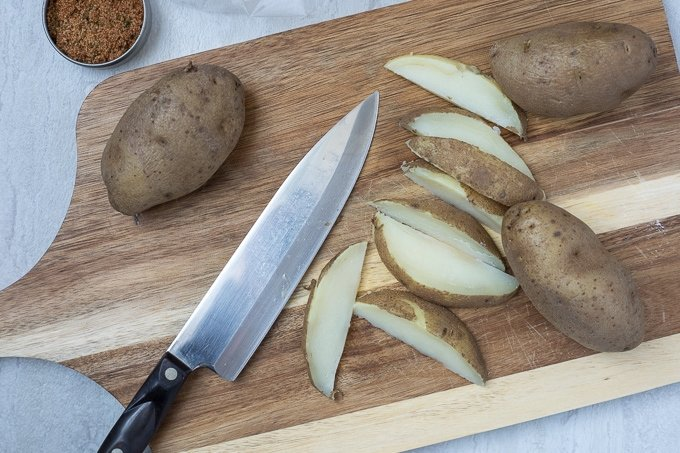 Cutting board with potato wedges