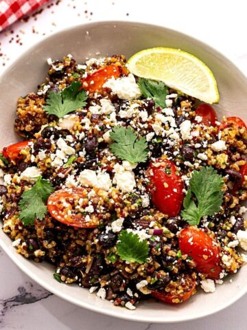 Quinoa Mexican Salad with Feta, Beans and Tomatoes in white bowl