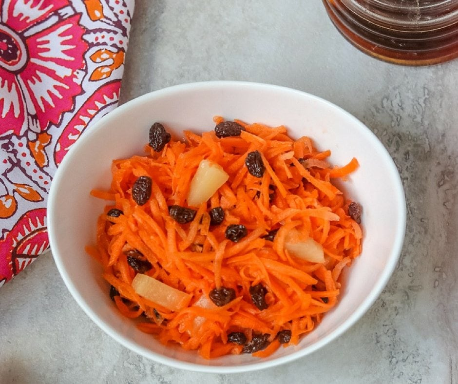 shredded carrots with pineapple, raisins and sweet and tangy dressing
