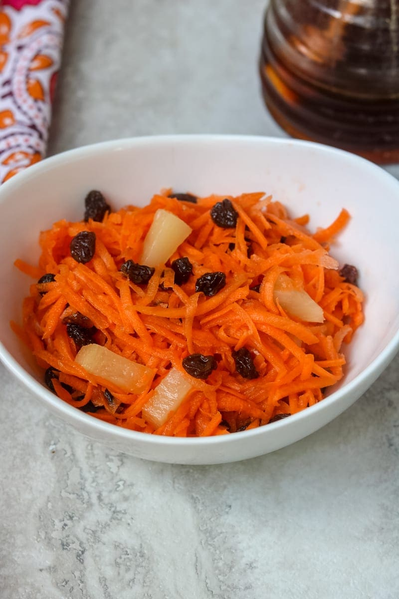 Clos up of Carrot Raisin Salad with pineapple and raisins