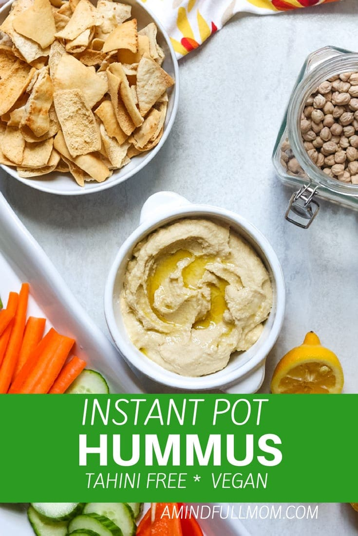 Instant Pot Hummus--This easy recipe for pressure cooker hummus is going to BLOW your mind! Made with dried chick-peas and wait for it-----sunflower seeds, this hummus recipe without tahini is going to become your new FAVORITE hummus recipe. You won't believe how easy restaurant quality hummus is to make at home.  #amindfullmom #hummus #instantpot #pressurecooker